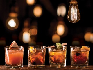 Four Old Fashioned cocktails