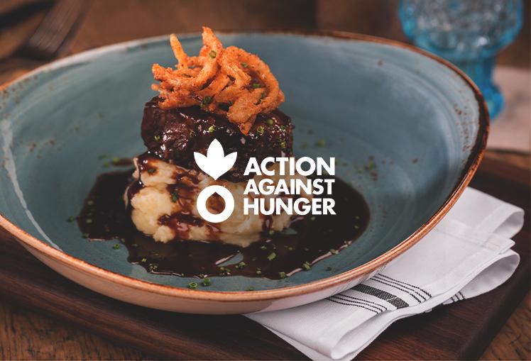 Action Against Hunger logo set over Searsucker's short rib dish.
